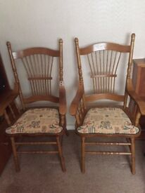 Two matching wooden chairs