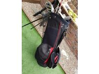 Golf clubs plus bag, balls, t's, 2 gloves and towel