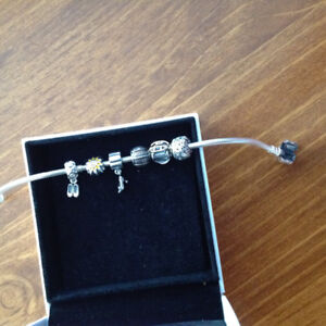 "New Pandora bracelet 7.5"" and charms"