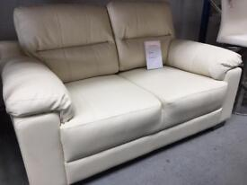 2 seater cream leather sofa ( new ). 2 available