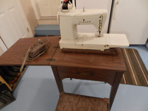 Singer Sewing Machine, Sewing Table & Chair		$90 OBO