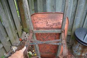 older wheel barrel with solid tire