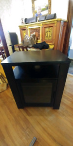 TV entertainment stand. Black. Solid wood construction.