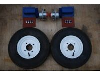 Trailer suspension units with wheels