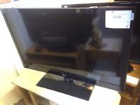 "Black 42"" LG TV with remote"