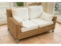 Wicker two-seater sofa