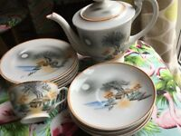 Vintage Japanese tea pot with one Geisha girl bottomed cup, six saucers and six tea plates.