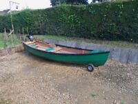 Outboard motor canoe, with British Seagull two stroke outboard motor. Will carry 3 adults.