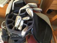 Golf bag, irons, tees and balls