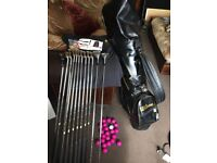 Wilson Golf Bag/ Arnold Palmer full set clubs/ Wilson Putter/ balls/ tees (new) Wilson Glove.