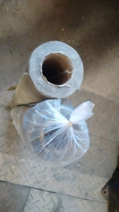 Double sided wax paper for underlayment for wood flooring