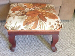 Padded antique footstool with beautiful wooden legs