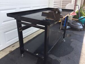Metal workbench with vise