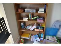 Wooden bookcase with a base shelf and five adjustable shelves. Priced cheaply due to relocation.