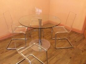Ikea glass table and four chairs.