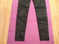 Burberry wax coated jeans.