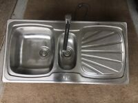 Stainless steel one and half kitchen sink.