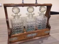 ANTIQUE OAK & SILVER PLATE THREE DECANTER TANTALUS WITH KEY.