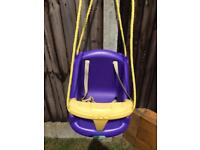 Baby swing seat with harness.