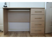 Computer desk with 4 drawers.