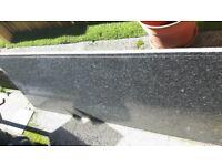 Grey speckled granite worktop