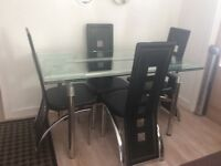 Extending glass table and 4 high backed black & chrome chairs