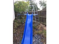 Climbing frame with monkey bars and slide