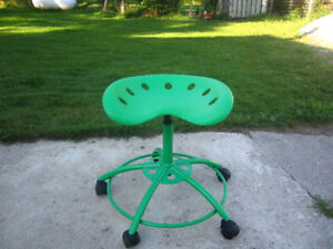 Green plastic formed roller stool seat