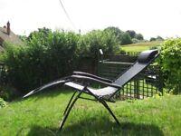 Black mesh reclining chair.