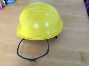 Yellow hard hat with adjustable knob and safety glasses