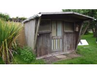 Wooden Summer House, needs a bit of attention but generally ok.