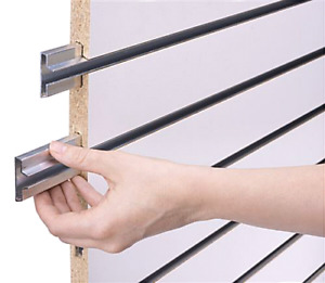 Slat wall sheets with metal inserts