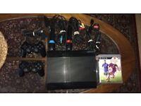 £70 PS3 SuperSlim Console 500GB Black + 2Dual shock controller+2 Singstar Microphones