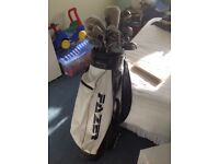 Golf bag with 25 assorted golf clubs.