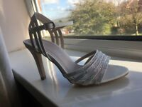Brand new! High heel silver shoes