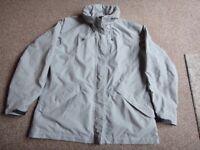 Rohan light grey ladies waterproof jacket with hood size Medium size 12 -14