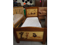 Hand carved child's bed and storage unit