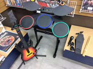 Ensemble Guitar Hero: 2 guitares/micro/drum + 5 jeux   #F022238
