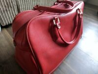 Red vintage suitcase weekend travel bag clothes storage retro