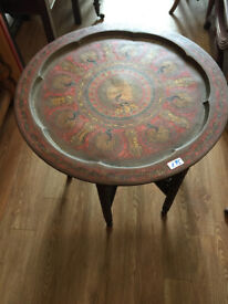 Brass Top table with fold away base , great design feel free to view Diameter 24 in Height 24 in