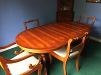 Extendable Yew veneer dining table, with 6 chairs (2 carver)