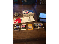 Nintendo 3DS XL (Boxed) with Super Mario Cart 7.