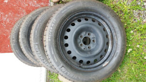 Michelin X-Ice 215/60/R17 tires on rims (x4)