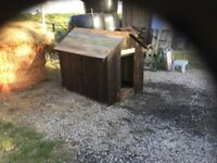 A very large dog kennel/ storage unit, or a child's play house.