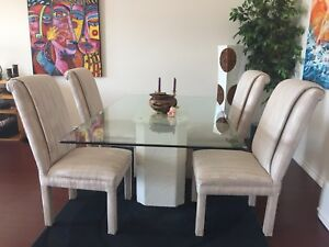 Glass dining table with 4 comfortable chairs.