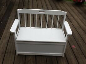 Childs White seat with storage box underneath .