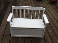 Childs White seat with storage box underneath .