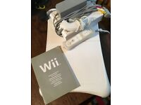 Wii console + Wii fit board, nunchuck and controller