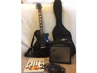 Complete electric guitar set with book and spares