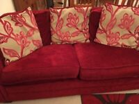 3 seater red sofa with cushions